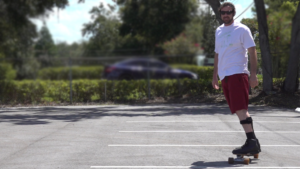 Man wears carbon fiber AFO on skatebboard.